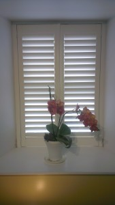Shutters with sun coming through